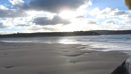 Offering help. Sun breaking through dark cloud St Ives Devon